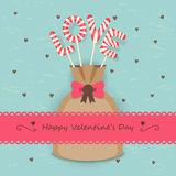 Love candy background. Love sweet candy in the bag with frame and ribbon on hearts background Royalty Free Stock Image
