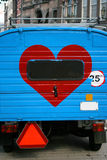 Love on a car. Heart shape in a blue minivan on a street in Amsterdam, Holland. You can easily add yours text inside the red heart royalty free stock photos