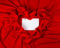 Love card with angel on a red fabric. Love card. white angel with message card on a red fabric Stock Image