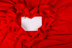 Love card with angel on a red fabric. Love card. white angel on white card on a red fabric heart Stock Image