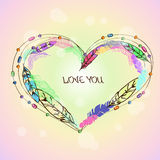 Love card with bird feathers. Love card with colorful bird feathers and beads in shape of heart Royalty Free Stock Photography