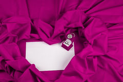 Love card with diamond ring on a purple fabric. Love card. purple jewel box with clock and diamond ring on white paper and purple fabric Stock Photo