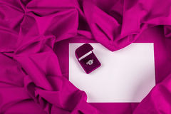 Love card with diamond ring on a purple fabric Stock Image