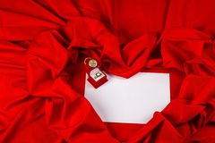 Love card with diamond ring on a red fabric. Love card. red jewel box with clock and diamond ring on white paper and red fabric Royalty Free Stock Image
