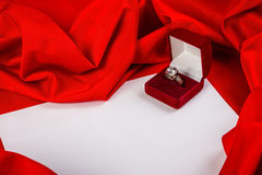 Love card with diamond ring on a red fabric. Love card. red jewel box with diamond ring on white paper and red fabric Royalty Free Stock Photography