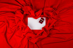 Love card with diamond ring on a red fabric. Love card. red jewel box with diamond ring on white paper and red fabric Royalty Free Stock Images