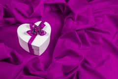 Love card with heart on a purple fabric Royalty Free Stock Photo