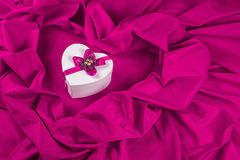 Love card with heart on a purple fabric. Love card. white heart with a purple ribbon on a purple fabric Royalty Free Stock Photography