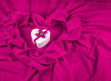 Love card with heart on a purple fabric Royalty Free Stock Images