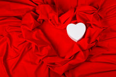 Love card with heart on a red fabric Stock Images