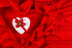 Love card with heart on a red fabric Royalty Free Stock Photography