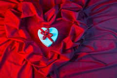 Love card with heart on a red fabric Royalty Free Stock Photo