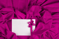 Love card with heart and ribbon on a purple fabric. Love card. message with heart and purple ribbon on a purple fabric Royalty Free Stock Images