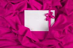 Love card with ribbon on a purple fabric Royalty Free Stock Images