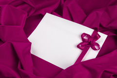 Love card with ribbon on a purple fabric Stock Image