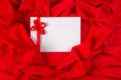 Love card with ribbon on a red fabric Stock Image
