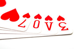 Love is on the cards. Love spelled in the symbols on playing cards Royalty Free Stock Image