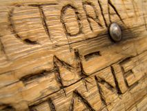 Love, carved into a bench. Abstract closeup of an eternal message carved into a wooden bench: victoria -n- shane Stock Images