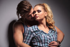 In love casual couple hugging with passion. Studio shot on gray background Royalty Free Stock Photo