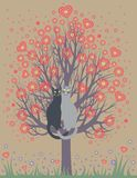 In love cats on a flowering tree Stock Image