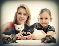 Love for cats. Girl hugging cats and show hands heart Royalty Free Stock Photo