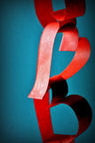 Love chain. Paper chain in red color with a heart formed links for Valentines day Stock Photography