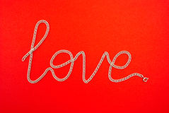 Love chainlet. Word love on the red background royalty free stock images