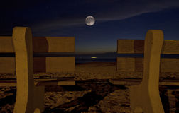 Love Chairs and Moon. Beach love chairs at full moon Stock Photo
