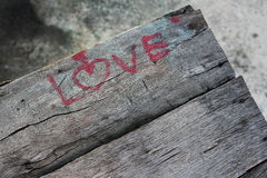 Love character valentine. Write love on the table Royalty Free Stock Photo