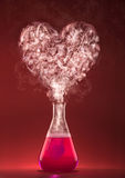 Love chemistry. Science experiment with heart shape smoke Stock Images