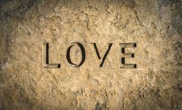 Love Chiseled Into Rock. Conceptual Image Of The Word Love Chiseled Into Stone Or Rock royalty free stock photos