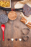 In love with chocolate. Ingredients for baking chocolate on a dark wooden background Stock Photography