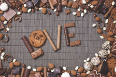 The love chocolate and sweets. The word 'love' of chocolate and candy on a dark background Stock Photos