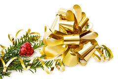 Love Christmas with golden bow. Celebrating Christmas with festive golden ribbons and red heart. Isolated over white background Royalty Free Stock Photography