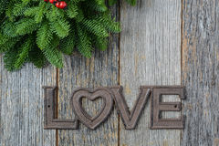 Love for Christmas Text with Pine Branches Royalty Free Stock Photos