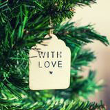 With love Christmas tree ornament branch of spruce tree. Close up. Selective focus. Merry Christmas and Happy New Year Concept. Sq royalty free stock images