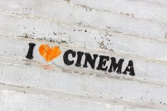 Love for cinematography. Advertising inscription on the steps of the cinema. The art of cinema. The evolution of filmmaking. Love for good movies. Invitation to royalty free stock photography