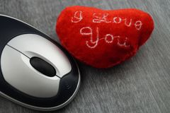 Love with a mouse click - Online Dating. Your eternal love might be only one click away Royalty Free Stock Image