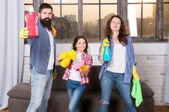 We love cleanliness and tidiness. Cleaning together easier and more fun. Family care about cleanliness. Start cleaning. Cleaning day. Family mom dad and royalty free stock photos