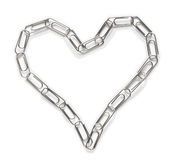 Love clips. Paper clips arranged in the shape of heart on the white background Stock Photography