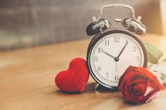 Love clock with heart and red rose vintage royalty free stock photo