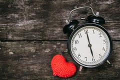 Love clock at 6 o`clock, Time of sweet loving pass memories. Stock Image