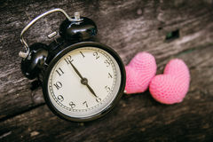 Love clock at 6 o`clock, Time of sweet loving pass memories. Love clock at 6 o`clock, Time of sweet loving pass memories story on the old wood background Stock Photos