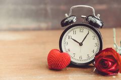 Love clock red heart and rose flower romantic time stock image