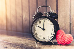 Love clock vintage tone timed 10 o`clock. Royalty Free Stock Photos