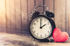 Love clock vintage tone timed 2 o`clock. Royalty Free Stock Photography