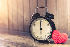 Love clock vintage tone timed 6 o`clock. Royalty Free Stock Images