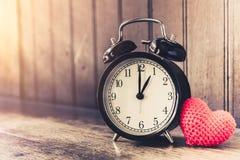 Love clock vintage tone timed 1 o`clock. Stock Photo