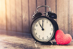 Love clock vintage tone timed 11 o`clock. Royalty Free Stock Photos