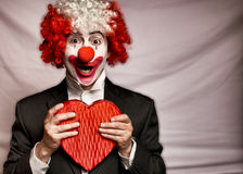 Love Clown. Colorful clown with  a box of candy  on a white background Royalty Free Stock Images